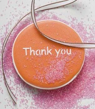 An orange biscuit with the words 'Thank you